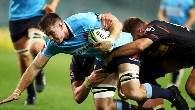 Jed Holloway of the Waratahs is tackled at Allianz Stadium.