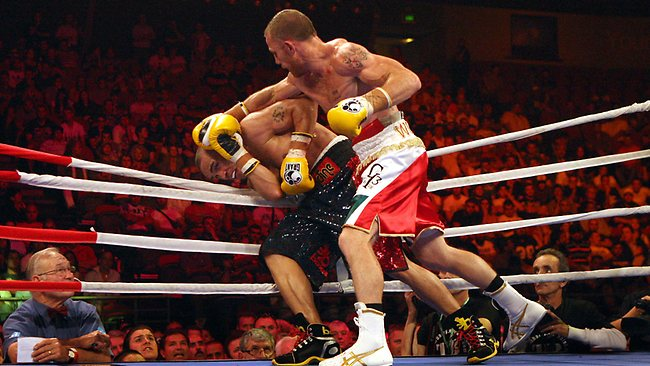 Mundine cannily tries his rope-a-dope strategy against Garth Wood before unluckily being knocked out. Picture: Mark Evans