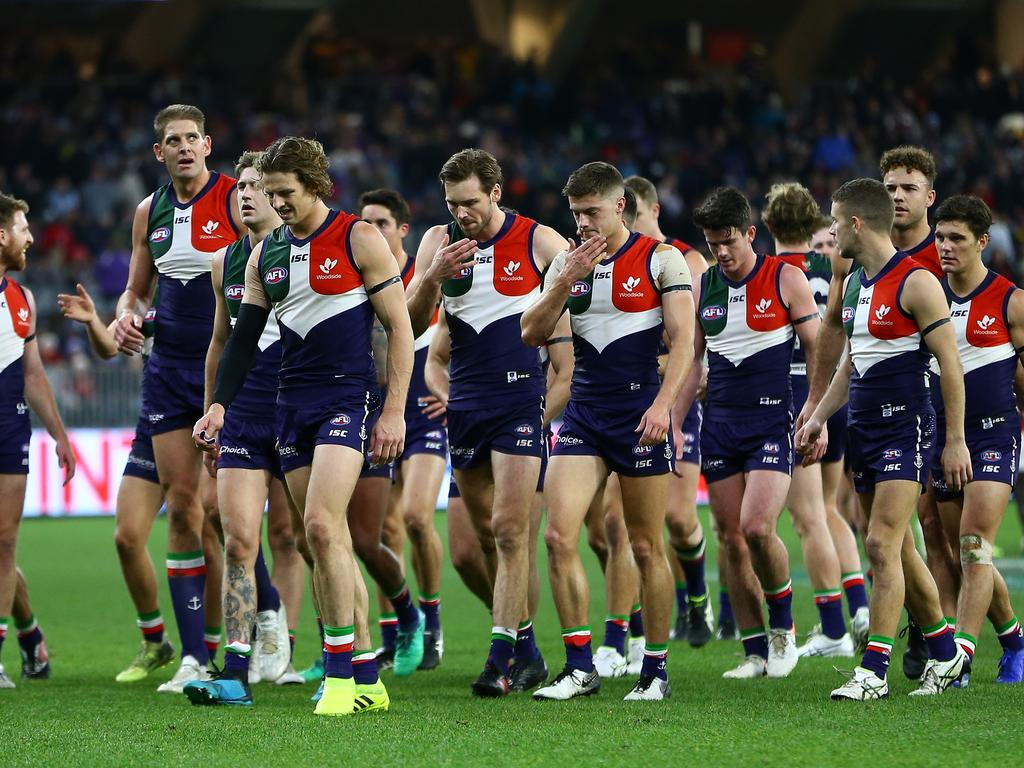 The Dockers walk off the field at half time during the Round 22 AFL match between the Fremantle Dockers and the Essendon Bombers at Optus Stadium in Perth, Saturday, August 17, 2019.  (AAP Image/Gary Day) NO ARCHIVING, EDITORIAL USE ONLY