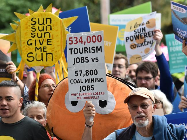 The Australian Youth Climate Coalition (AYCC) and the Australian Conservation Foundation (ACF) hold a rally against the federal government and Indian company Adani at Treasury Place in Melbourne on Monday. Picture: Julian Smith/AAP