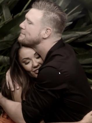 Davina and Dean shared a sneaky embrace at one of the dinner parties.
