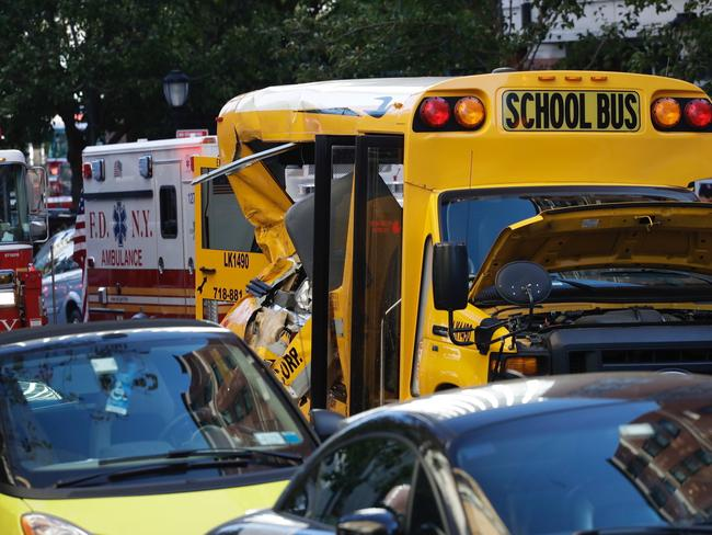 The man appears to have smashed into a school bus. Picture: AP