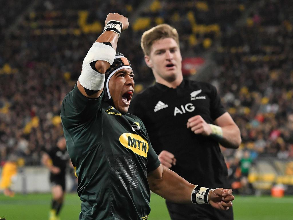 TOPSHOT - South Africa's Cheslin Kolbe celebrates a try during the Rugby Championship match between the New Zealand All Blacks and South Africa at Westpac Stadium in Wellington on September 15, 2018. (Photo by Marty MELVILLE / AFP)