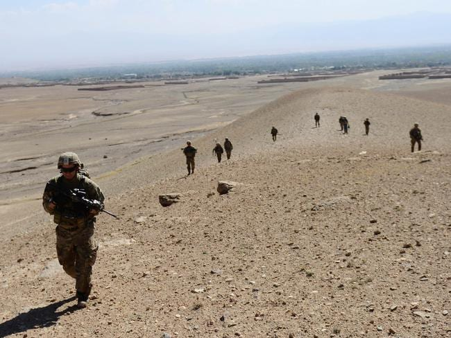 Hard slog ... US Delta Force troops trained hard for the July 3 raid. Here, US Marines scour the hills near their base in Afghanistan. Source: AFP