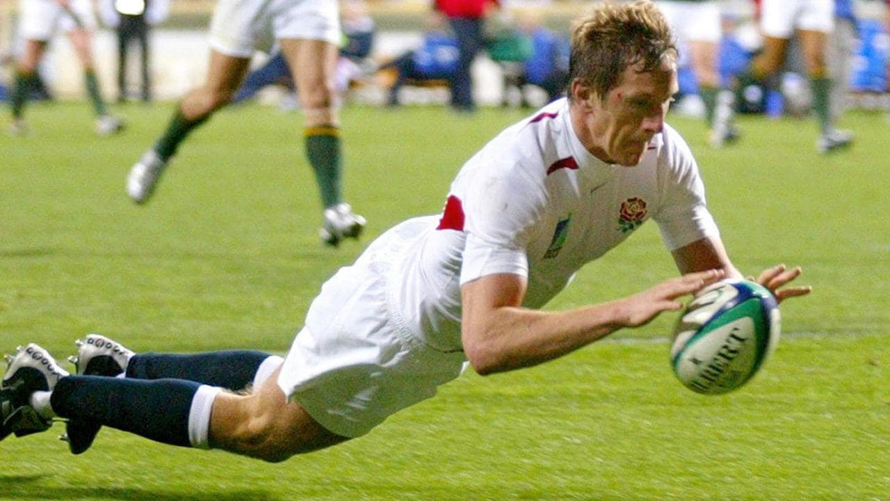 Will Greenwood goes over to score during an England v South Africa World Cup match.