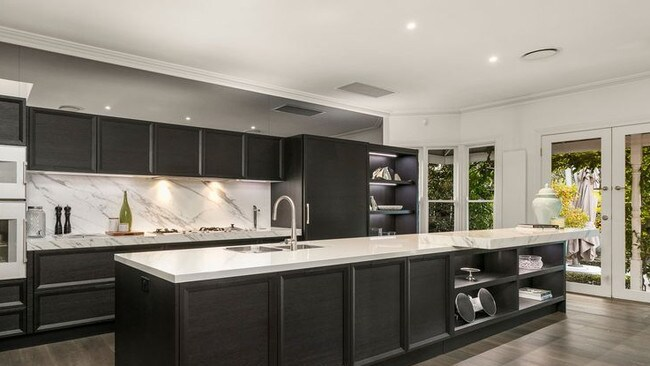 The imported Italian kitchen with Calacatta marble finishes and Gaggenau appliances.
