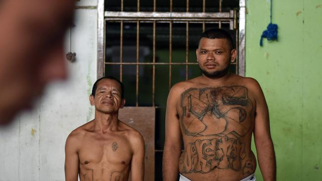 Former members of Salvadoran gangs — mostly of the Mara Salvatrucha (MS-13) and Barrio 18 — claim to be willing to endure a painful process of laser technology, that can take years, to erase tattoos they now say were a 'youth mistake'. Picture: Oscar Rivera / AFP