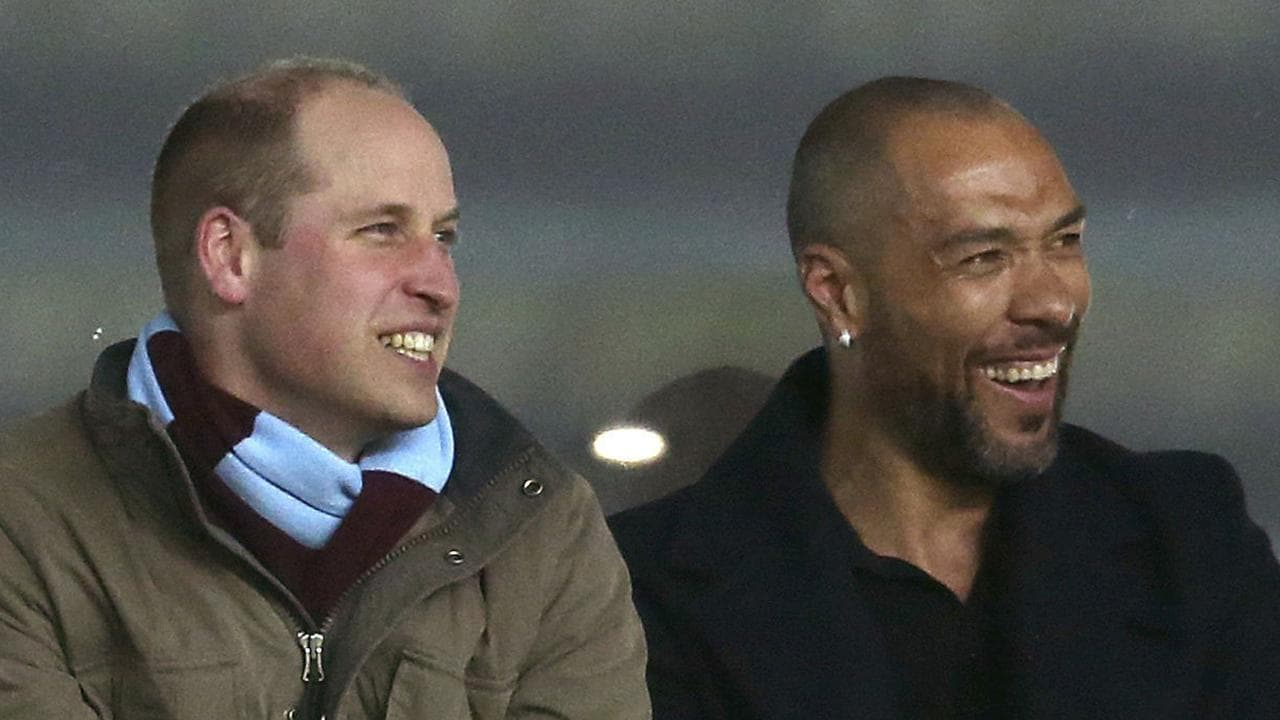 Britain's Prince William and former Norwegian international soccer player John Carew watch in an executive box.
