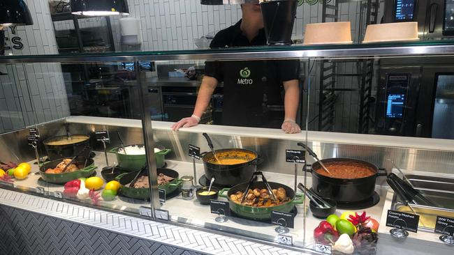 The store is the first Woolworths to have a full hot food to go offer including sushi, poke bowls, pizza, salads, curries, coffee and even hot roast dinners. Picture: Benedict Brook