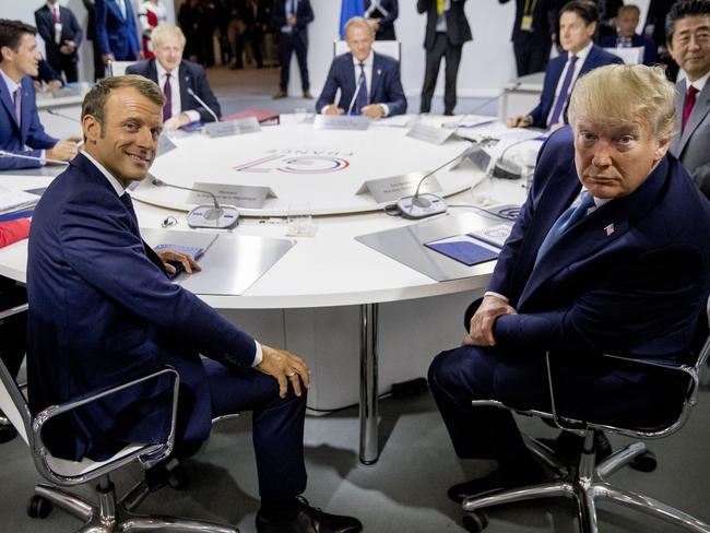 French President Emmanuel Macron, Centre Left, and President Donald Trump, centre right, participate in a G-7 Working Session. Picture: AP