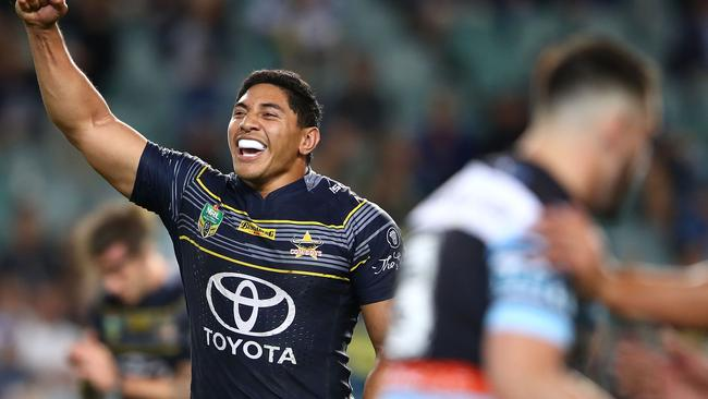 Jason Taumalolo raises his arm in triumph.