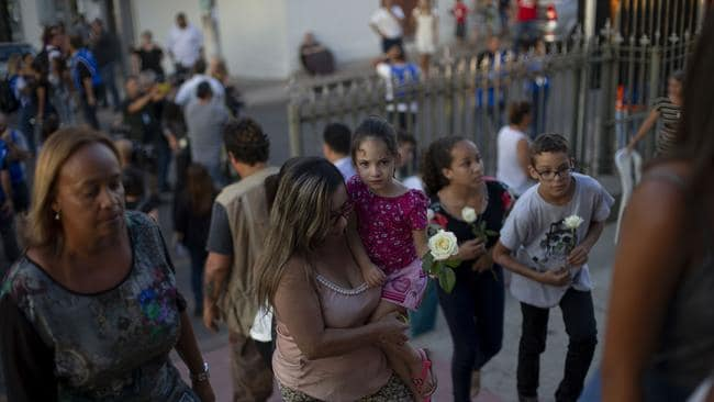 People arrive at the Brumadinho Matriz Church to attend a service. Picture: Mauro Pimentel/AFP