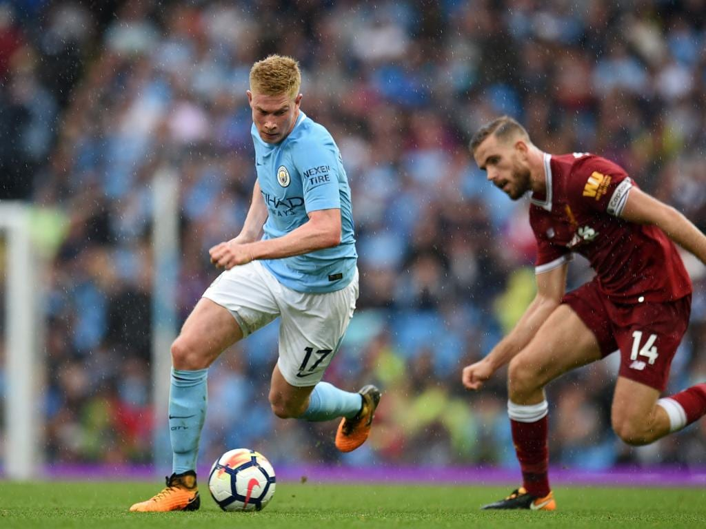 Manchester City's Belgian midfielder Kevin De Bruyne (L) runs away from Liverpool's English midfielder Jordan Henderson during the English Premier League football match between Manchester City and Liverpool at the Etihad Stadium in Manchester, north west England, on September 9, 2017. Manchester City won the game 5-0. / AFP PHOTO / Oli SCARFF / RESTRICTED TO EDITORIAL USE. No use with unauthorized audio, video, data, fixture lists, club/league logos or 'live' services. Online in-match use limited to 75 images, no video emulation. No use in betting, games or single club/league/player publications.  /