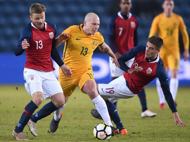 Aaron Mooy of Australia in action with Fredrik Midtsjo of Norway (L) and Markus Henriksen of Norway (R). (Photo by Michael Regan/Getty Images)