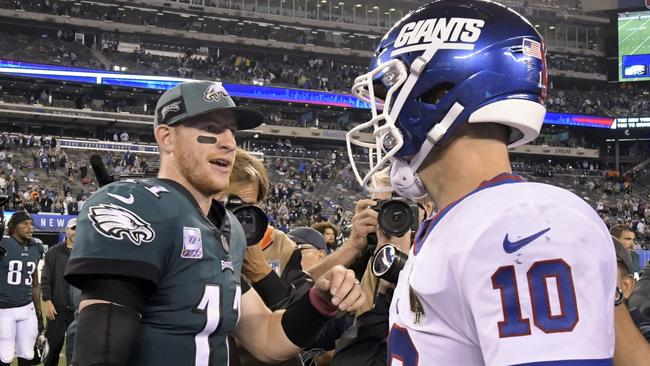 Philadelphia Eagles quarterback Carson Wentz (11) shakes hands with New York Giants quarterback Eli Manning (10) after the game. Picture: AP Photo