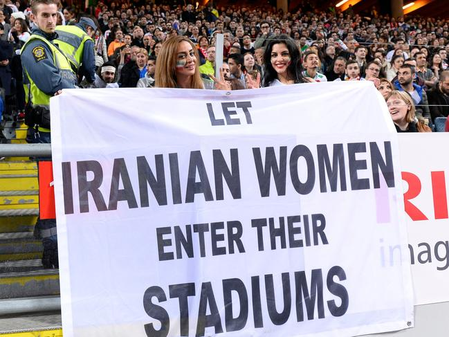 Supporters hold a banner reading 'Let Iranian women enter their stadiums' during the friendly international football match between Sweden and Iran near Stockholm. Picture: AFP