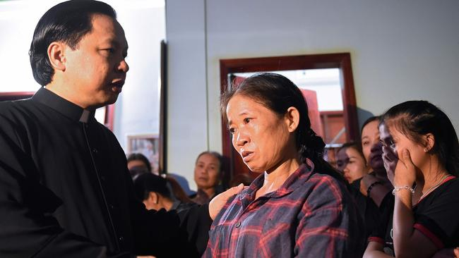 Tran Thi Hien, mother of Bui Thi Nhung, who is feared to be among the 39 people found dead in the truck, is consoled inside her house in Vietnam. Picture: Nhac Nguyen/AFP