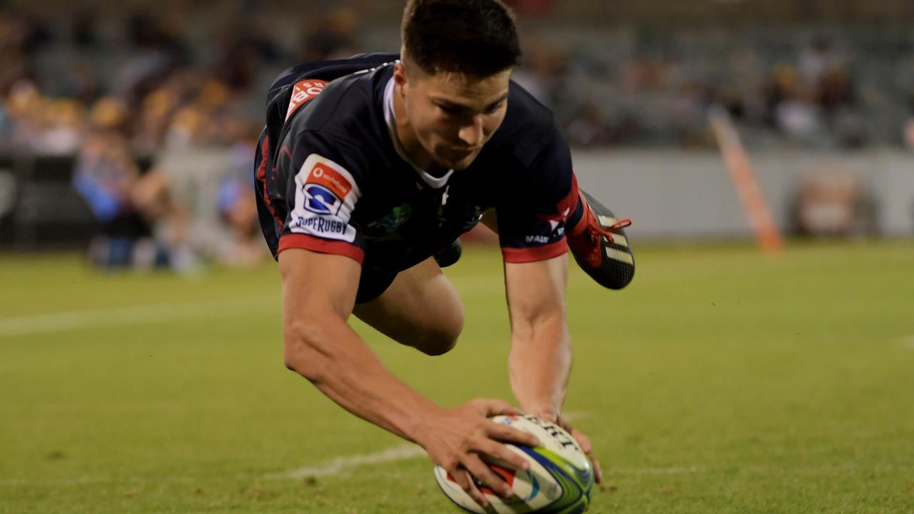 Jack Maddocks of the Rebels scores a try at GIO Stadium.