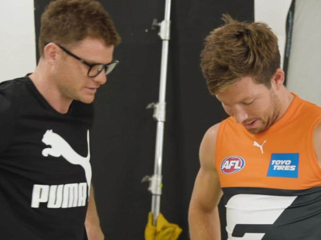 Heath Shaw and Toby Greene study the new GWS guernsey in a video released by Puma.