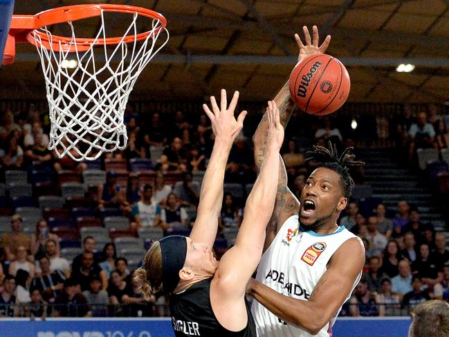 Eric Griffin of Adelaide is blocked by EJ Singler of the Bullets. Picture: Bradley Kanaris/Getty Images