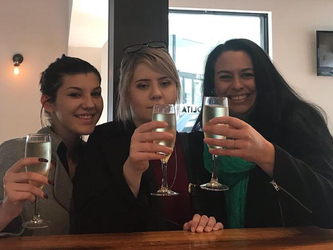Jodie, Jess and Annie celebrating after Willats was jailed last year. Picture: Supplied