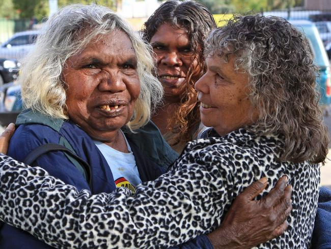 Happy with the result ... traditional owners of Muckaty Station, Doris Kelly, Gladys Brown and Elaine peckham embrace after the announcement that the planned radioactive waste dump was abandoned. Picture: Phil Williams