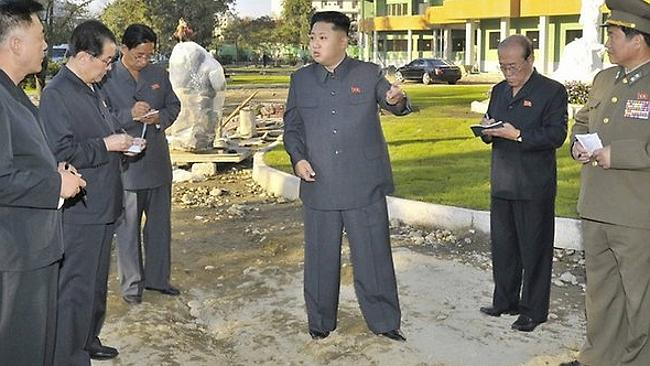 North Korea's exalted leader appears to be floating in front of the new hospital. Picture: AFP/KCNA