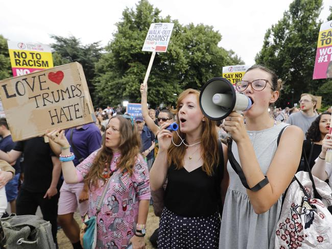 Protesters against the visit of US President Donald Trump gathered with placards at a barrier set up to block access to the US ambassador's residence Winfield House in Regent's Park last night. Picture: AFP