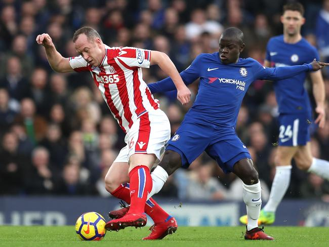 Charlie Adam is tackled by N'Golo Kante. (Photo by Catherine Ivill/Getty Images)
