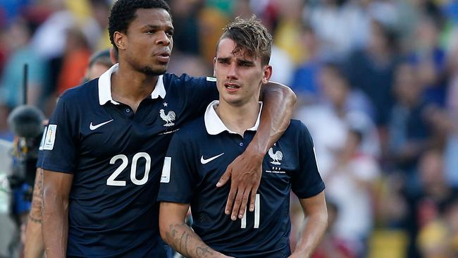 Loic Remy with Antoine Griezmann after France's elimination from Brazil.