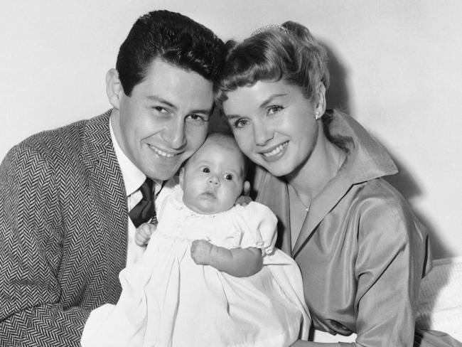 Eddie Fisher and Debbie Reynolds hold their baby daughter, Carrie Frances Fisher, in this 1957 photo. Picture: AP