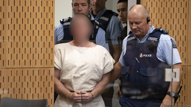 Brenton Tarrant being led into the dock for his appearance in the Christchurch District Court on March 16. Picture: Mark Mitchell/Getty Images)