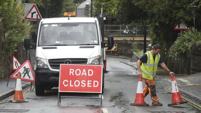 A roadblock is put in place at Whaley Lane. British police have ordered the evacuation of a town of 6500 residents. Picture: Danny Lawson/PA via AP