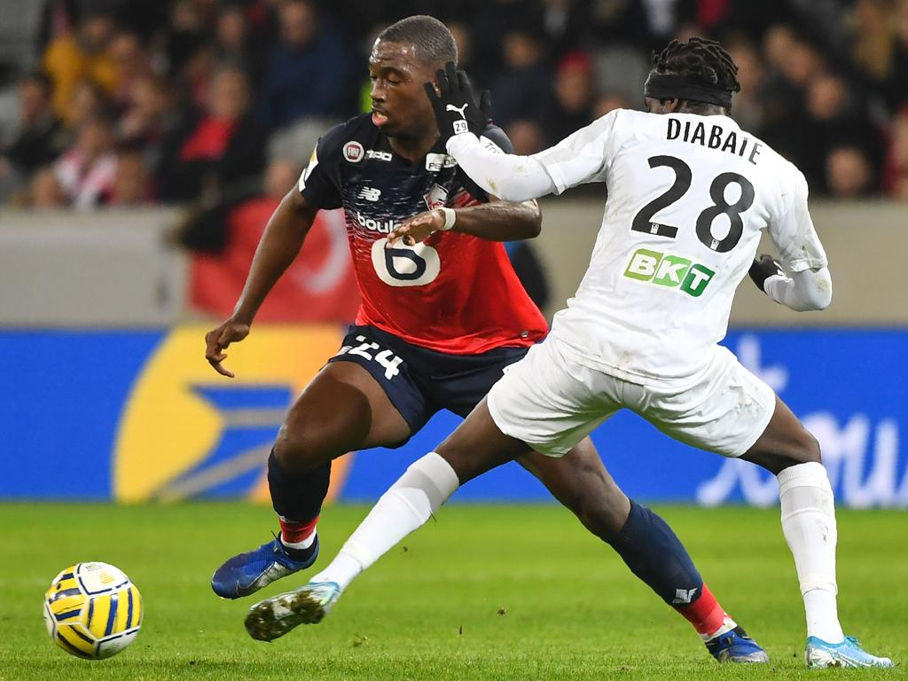 Lille's French midefielder Boubakary Soumare (L) vies with Amiens' midfielder Fousseni Diabate during the French Ligue Cup quarterfinal football match between Lille LOSC and Amiens SC at the Pierre-Mauroy stadium in Villeneuve-d'Ascq, near Lille, northern France on January 8, 2020. (Photo by DENIS CHARLET / AFP)
