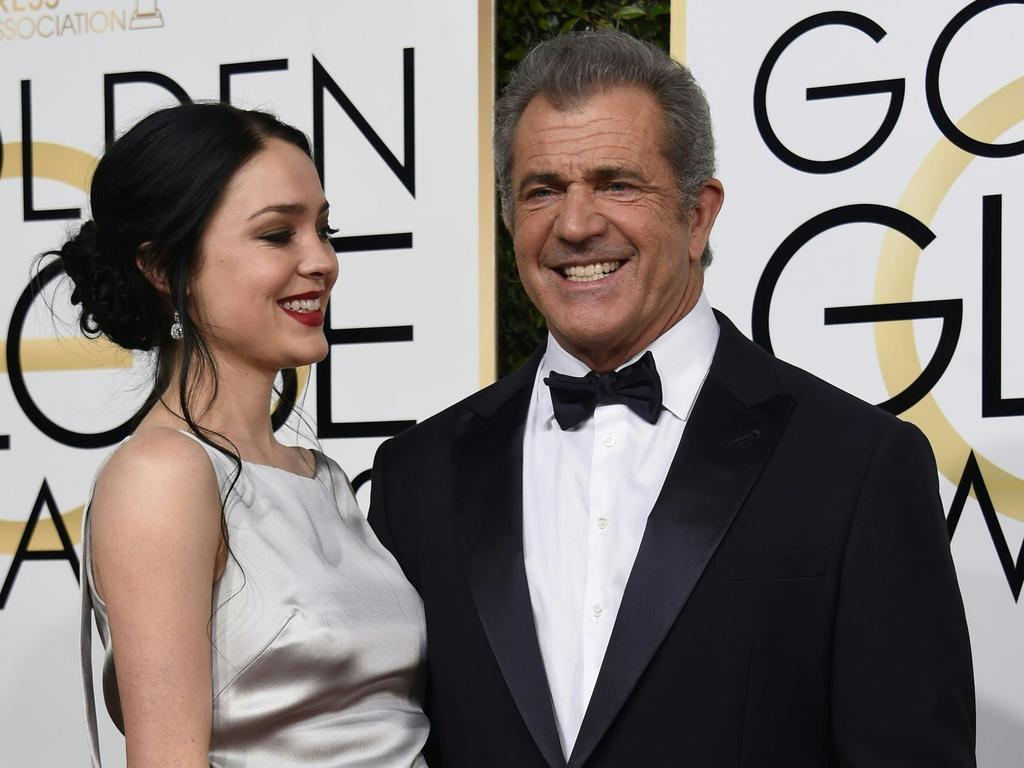 Mel Gibson (R) and girlfriend Rosalind Ross.