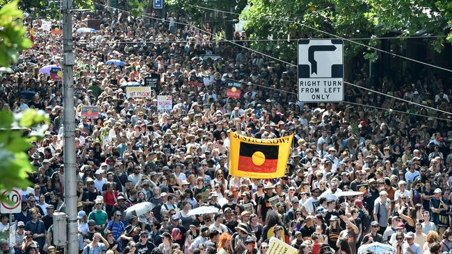 Protesters marching from Spring St to Flinders Street Station. Picture: Jason Edwards
