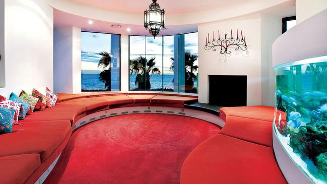 The red living room is one of May's favourite features of the house.