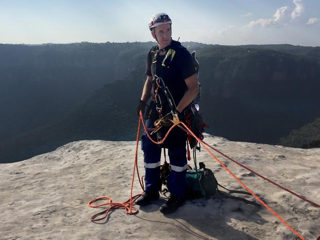 Paramedic Damon Anderson prepares to abseil down the cliff to assist Isaac Ebeling. Picture: NSW Ambulance Media