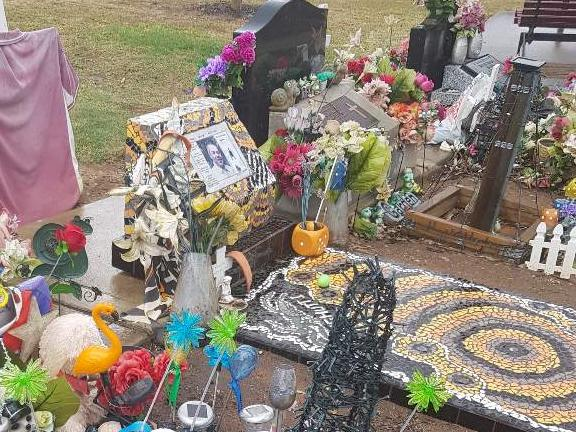 Many other graves near Trent's are decorated in a similar fashion.