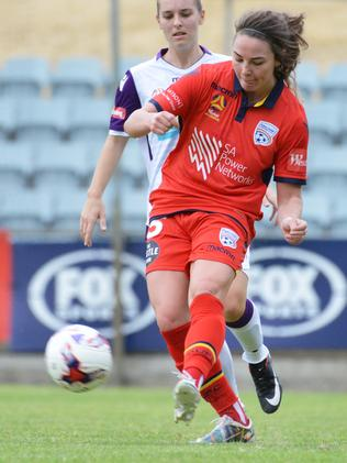 Adelaide United's Jenna McCormick passes the ball during the Reds' W-League clash with Perth Glory. Picture: AAP Image/ Brenton Edwards