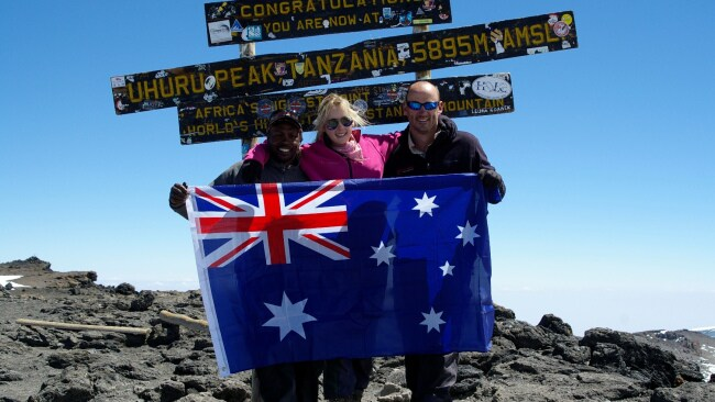 Alyssa with her dad and guide on the summit of Mt Kilimanjaro. Image: Supplied