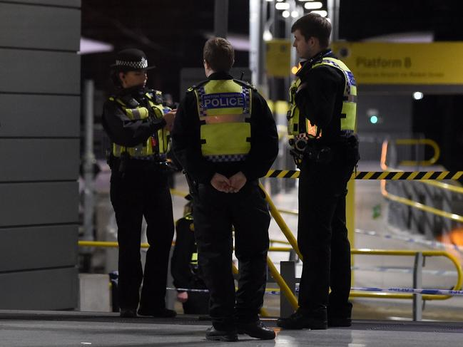 Police officers stand near a cordon at Manchester Victoria Station. Picture: AFP
