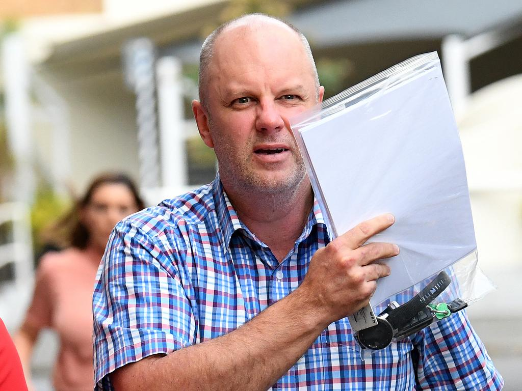 Doctor John Robert Ullman leaves the police watch house in Brisbane. Picture: NCA NewsWire / Dan Peled