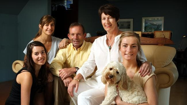 The Abbotts at home with their dog in 2009.