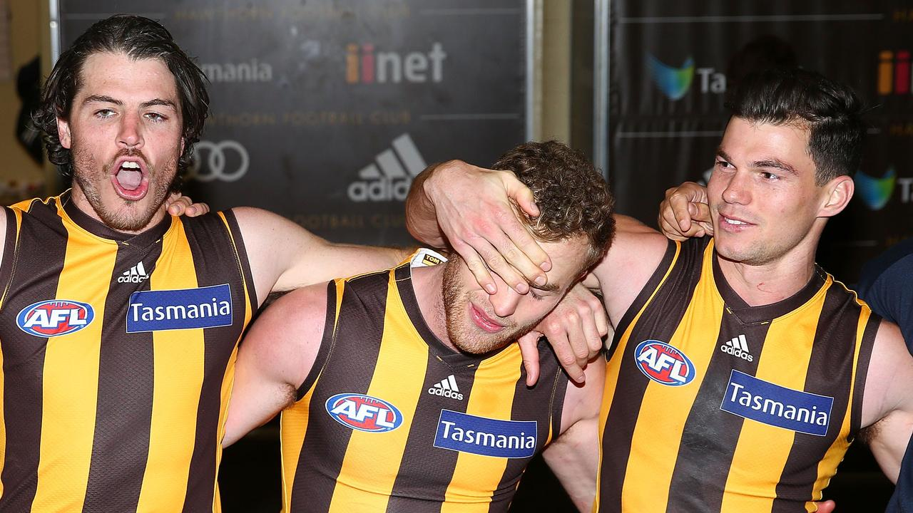 Hawthorn stars Isaac Smith, Tom Mitchell and Jaeger O'Meara celebrate a win.