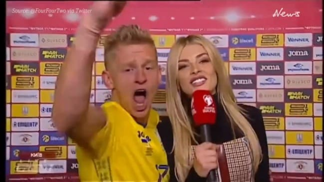 Football star goes bananas with WAG reporter on live TV