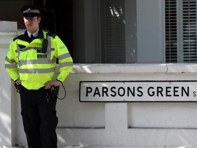 A police officer stands next to a street sign near Parsons Green Underground Station. Picture: Getty Images