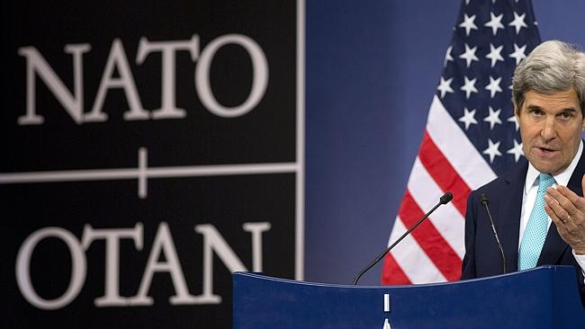 Tough talk ... US Secretary of State John Kerry speaks during a media conference after a meeting of the NATO-Ukraine Commission at NATO headquarters in Brussels. Picture: Virginia Mayo