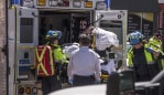 A injured person is put into the back of an ambulance in Toronto after a van mounted a sidewalk crashing into a crowd of pedestrians on Monday, April 23, 2018. The van apparently jumped a curb Monday in a busy intersection in Toronto and struck the pedestrians and fled the scene before it was found and the driver was taken into custody, Canadian police said. (Aaron Vincent Elkaim/The Canadian Press via AP)