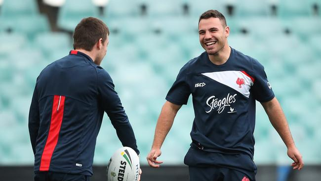 Sean O'Sullivan (R) jokes around with Luke Keary during Roosters training ahead of their Grand Final match. Picture. Phil Hillyard